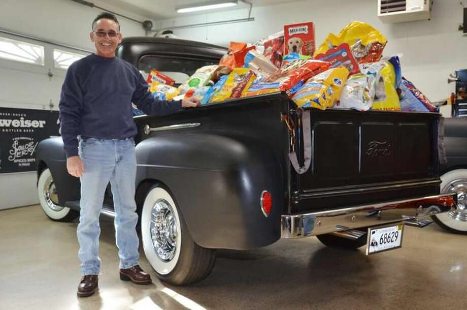 Submitted Photo Larry (Bones) Geraci is shown with his truck full of donations for Animal Haven.