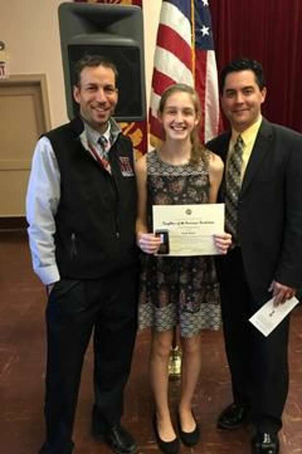 Submitted Photo Sarah Boney, center, displays her Good Citizenship Award at the Good Citizens Ceremony at the Spring Glen Church in Hamden on Nov. 16. Pictured with Boney are school counselor Anthony Giamattei, left, and school principal Philip Piazza, right.