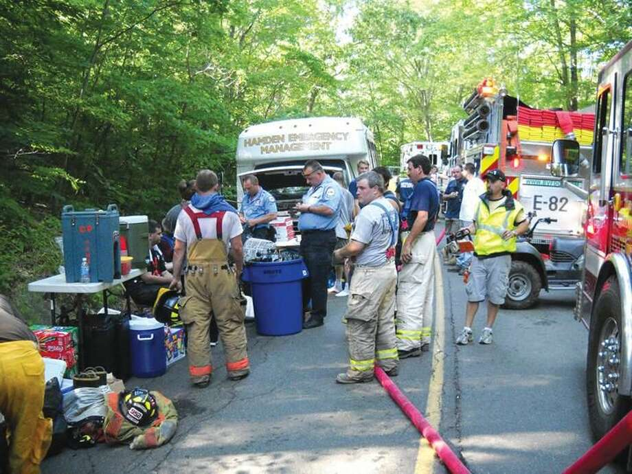 Submitted Photo Hamden CERT provided relief and assistance to crews battling a brush fire in 2013.