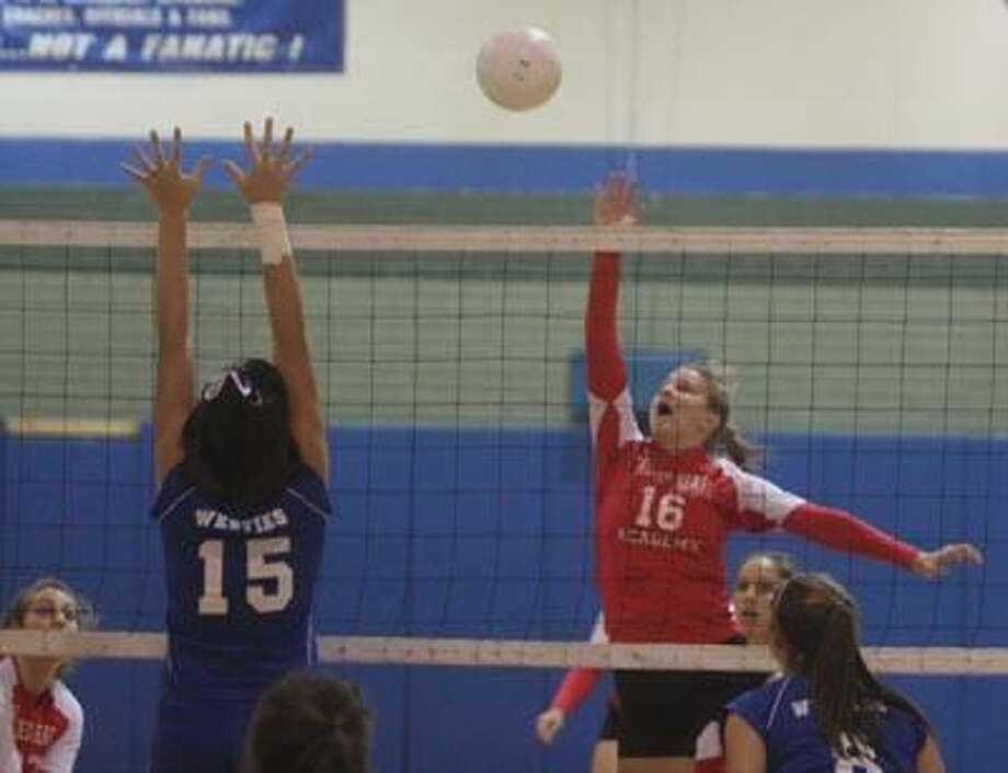 Sacred Heart's Clare Kane hits the ball over the net in a regular-season match against West Haven. (Photo by Russ McCreven).