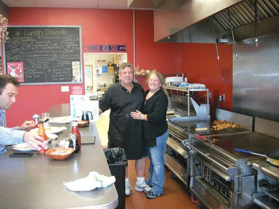 Photo by Lynn Fredricksen Scott and Lori Vincent at the open concept grill behind the breakfast counter at Scotty's Breakfast Connection, 344 Washington Ave. At the counter customer Elliot Gould is enjoying a meal.a