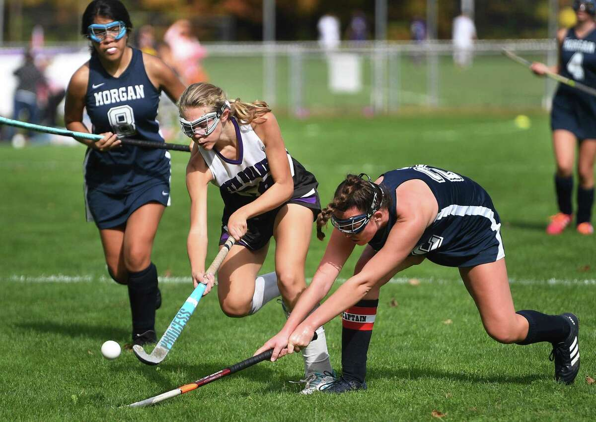 North Branford's Aly Kendrick plays the ball ahead of Morgan defender Delaney Mastriano during their field hockey game in North Branford, Conn. on Monday, October 13, 2019.