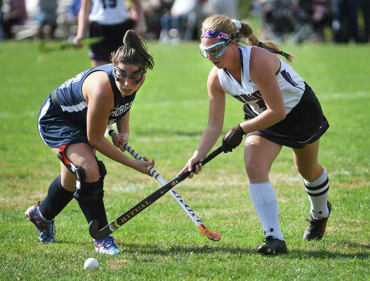 Morgan's Caitlin Rohrbacher, left, battles for the ball with North Branford's Kelli Jacobsen on Oct. 13.