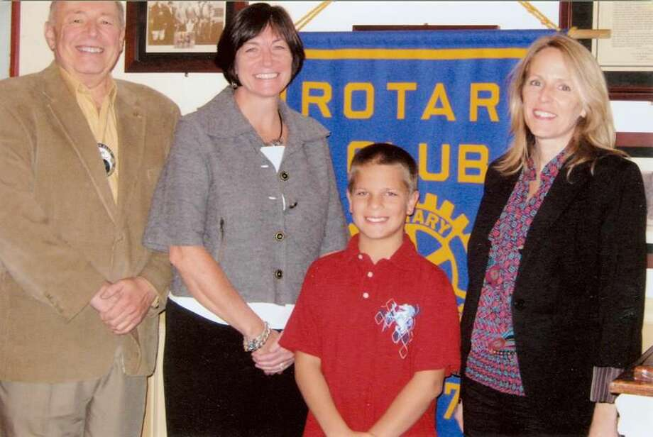 Submitted Photo Hamden Rotary Club has honored Justin Mitchell as its November Student of the Month. Shown with Justin are Rotary Club President John Karavas, teacher Mary Dunn, and school principal Susan Smey.