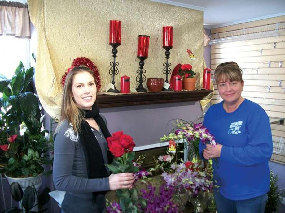 Photo by Lynn Fredricksen Sharon Kohary (right) and Karen Morgan (left) are busy getting Forget Me Not flower shop fully stocked in anticipation of Valentine's Day on Friday. The full service flower shop is also enjoying some notoriety having again received the WeddingWire Couple's Choice Award.