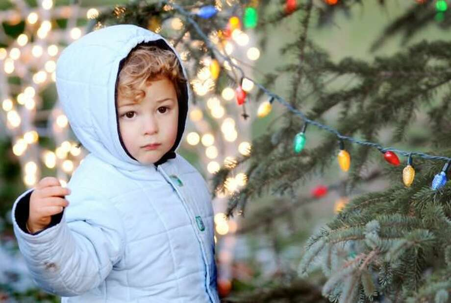 Photo by Melanie Stengel/Register Milan Petrosyan, 2, of Hamden, is mesmerized by the sights and sounds of the Sivlerbells celebration.