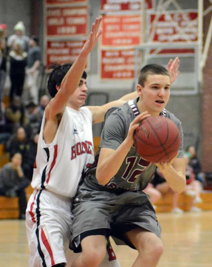 Photo by Dave Phillips Freshman Jack Steinman, shown against Branford earlier this season, hit a game-winning 3-pointer at the buzzer to lift North Haven to a thrilling 44-43 comeback victory over Shelton on Saturday.