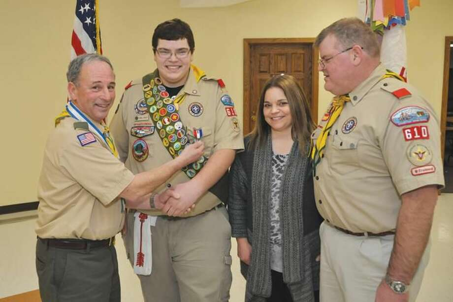 Submitted Photo Left to Right; Scoutmaster Bill Earley congratulates Eagle Scout Daniel Faherty with parents Jackie & Chris Faherty.