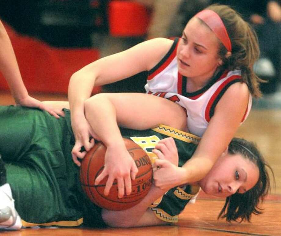 Rebecca Palmarozza and Hamden wrestled away a 43-38 victory from Cheshire last Friday night. (Photo by Brad Horrigan/ New Haven Register)