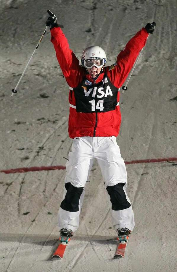 Eliza Outtrim, of the United States, celebrates after crossing the finish line during the women's freestyle World Cup moguls event Saturday, Jan. 11, 2014, in Park City, Utah. Outtrim came in fourth place. (AP Photo/Rick Bowmer)