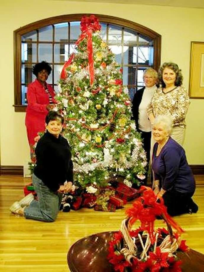 Submitted Photo Pictured with the decorated tree is Lynda O'Donnell, Carmen Sealy, Judy Neubig, Emily Cosenza and Barbara Flood.