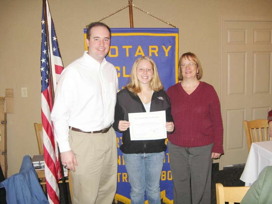 Submitted photo by David Marchesseault, Rotary Secretary Rotarians Brian Coughlin and Bernadette Casella present the Unsung Hero Award for the fall to Kalie Siciliano.