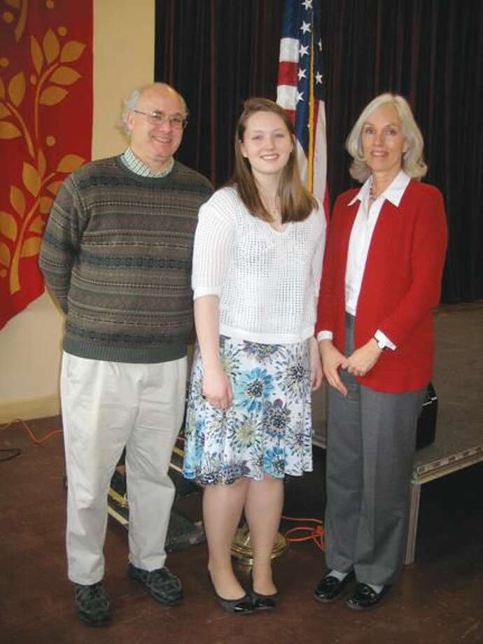 Submitted Photo Catherine Lindsay, center, was awarded the Emily Louise Gerry Scholarship. Joining Catherine are her parents, Leigh Cromey and David Lindsay.