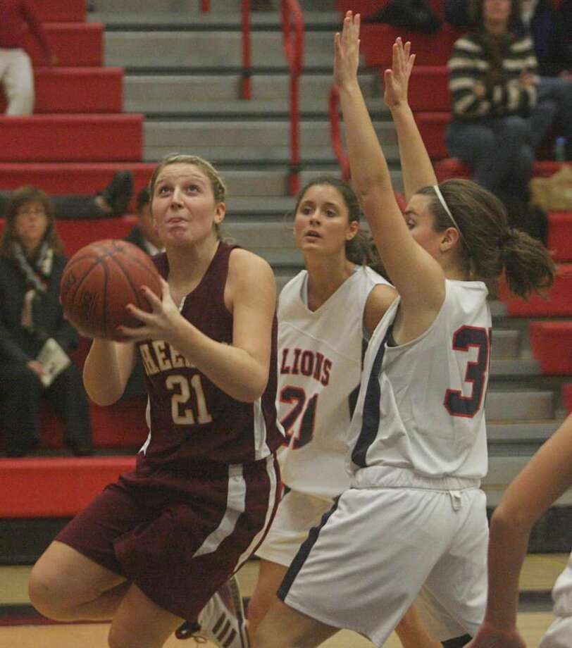 Sheehan's Rachel Collette eyes the basket in the Titans' season-opening 58-54 victory over Foran last Friday night in Milford. Collette scored 11 points in the win, while Bre Butler finished with a team-high 19 points. (Photo by Russ McCreven)