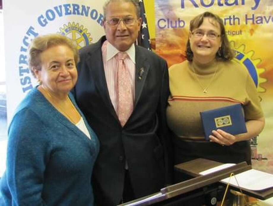 Submitted Photo Eileen and Farooq Khan were awarded special recognition from Rotary District 7980 for their ongoing generosity to Rotary International by North Haven's club president, Debbie Volain.