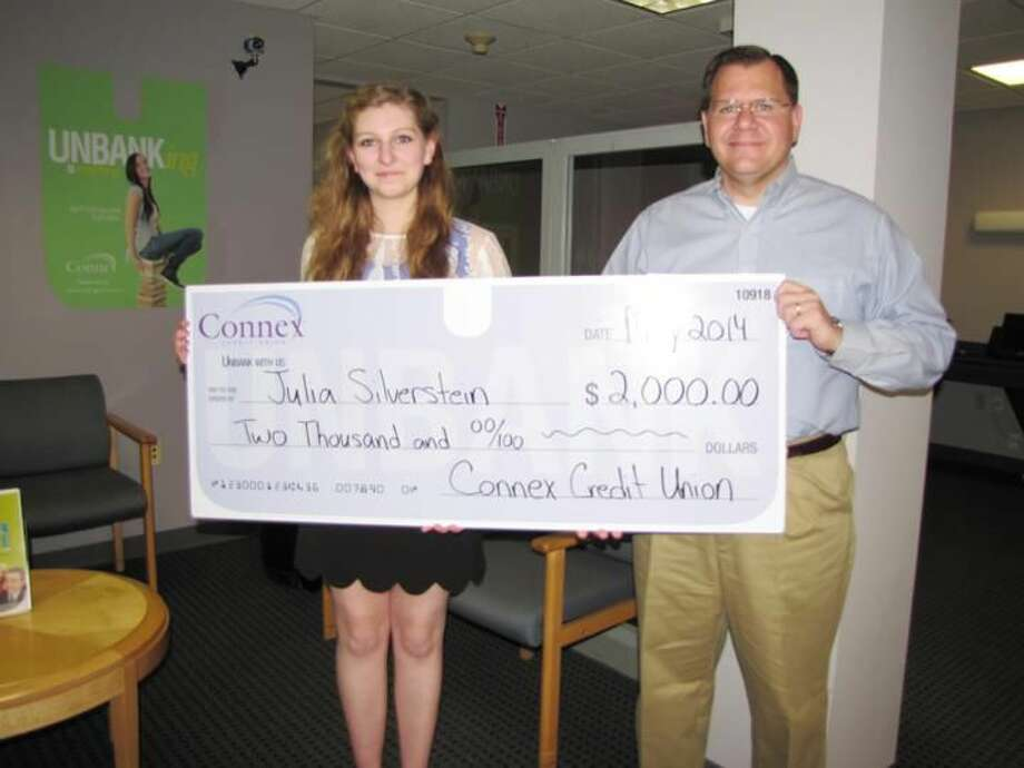 Submitted Photo Julia Silverstein, a senior at North Haven High School, accepts a scholarship award from Carl J. Casper, vice president of customer advocacy, Connex Credit Union.