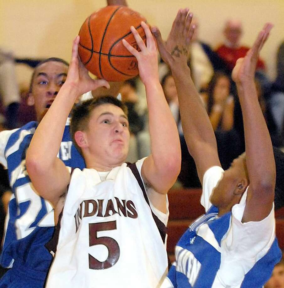 North Haven's Brian Salzillo lines up his shot in the Indians' 50-49 win over West Haven. Salzillo scored a game-high 21 points but dished out an assist to Billy McDonald for the game-winning shot with 4 seconds to go in the game. (Photo by Mara Lavitt/ New Haven Register)