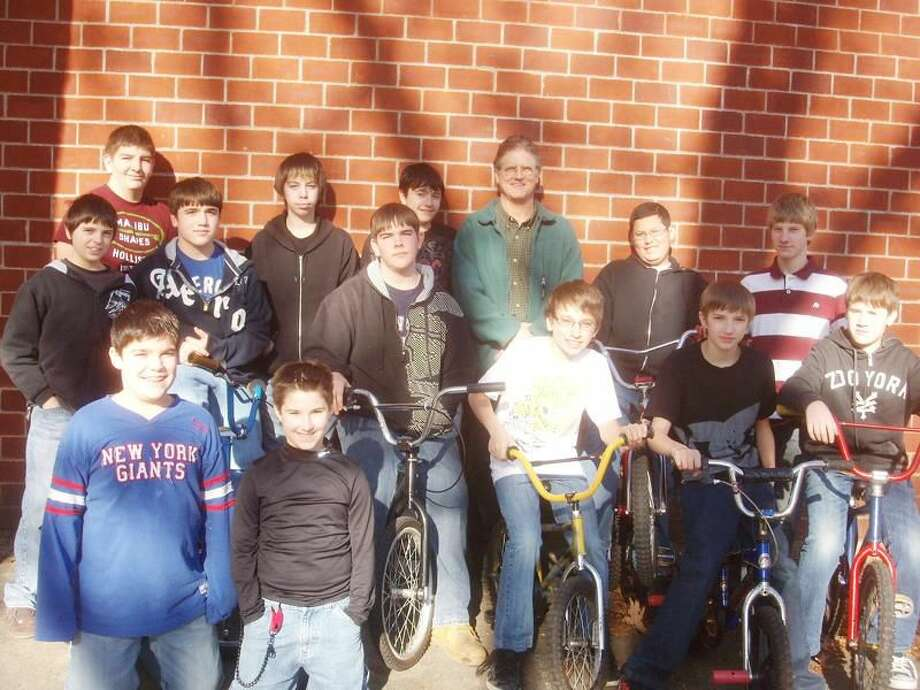 Submitted Photo The members of the North Haven Middle School Bike Club are 8th graders Matt M., Chris D., Nick B., Jay K., Pat P., Zack C., Billy S. and Shawn C. (not in photo); 7th grader Josh L.; and 6th graders Mike K. (not in photo), Nick D. and Brandon B. This year the Bike Club is fortunate to have three 9th grade students from North Haven High School assisting and mentoring their younger peers. They are Jim P., Joe G. and Chas P. The student members learn teamwork, cooperation, collaboration, bicycle repair skills and enjoy working for a common cause in the camaraderie of their peers.