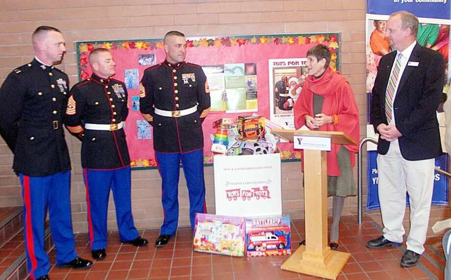 Photo by Joseph Cole Left to right: Captain Theodore (Ted) Smith, 1st Sergeant James Knapp, Gunnery Sergeant Brian Musco, Congresswoman Rosa DeLauro, and Jeff Williams, executive director of the Hamden/North Haven YMCA.