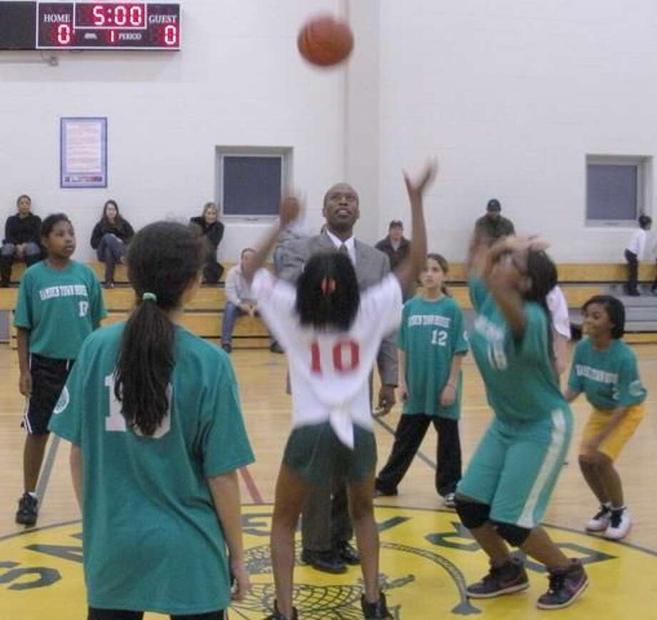 Hamden Mayor Scott Jackson throws the opening jump ball in the Hamden Fathers Girls Basketball 9-11 Year-Old League. (Submitted photo)