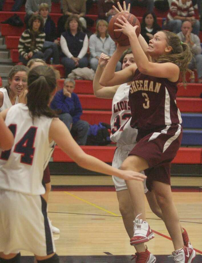 Sheehan's Bre Butler drives to the basket in a recent game against Foran. Butler scored 20 points and grabbed 17 rebounds to lead the Titans to a 51-34 victory over Sacred Heart last week. Teammate Mollie Hammel added 11 points. (Photo by Russ McCreven)