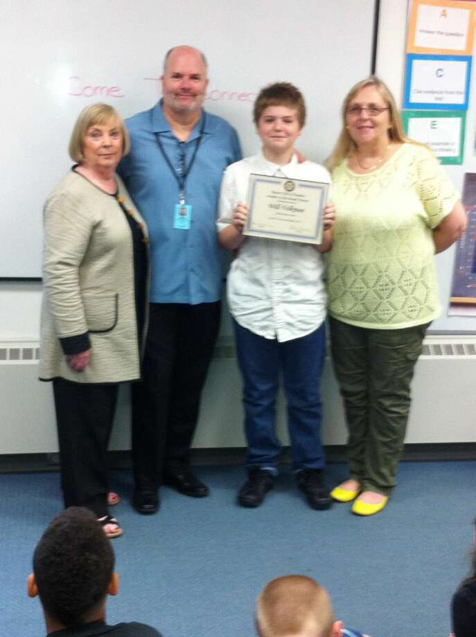 Submitted Photo Pictured with Will Volkman are Rotarian Betsy Gorman, Principal Michael Lorenzo and teacher Kathy Riordan.
