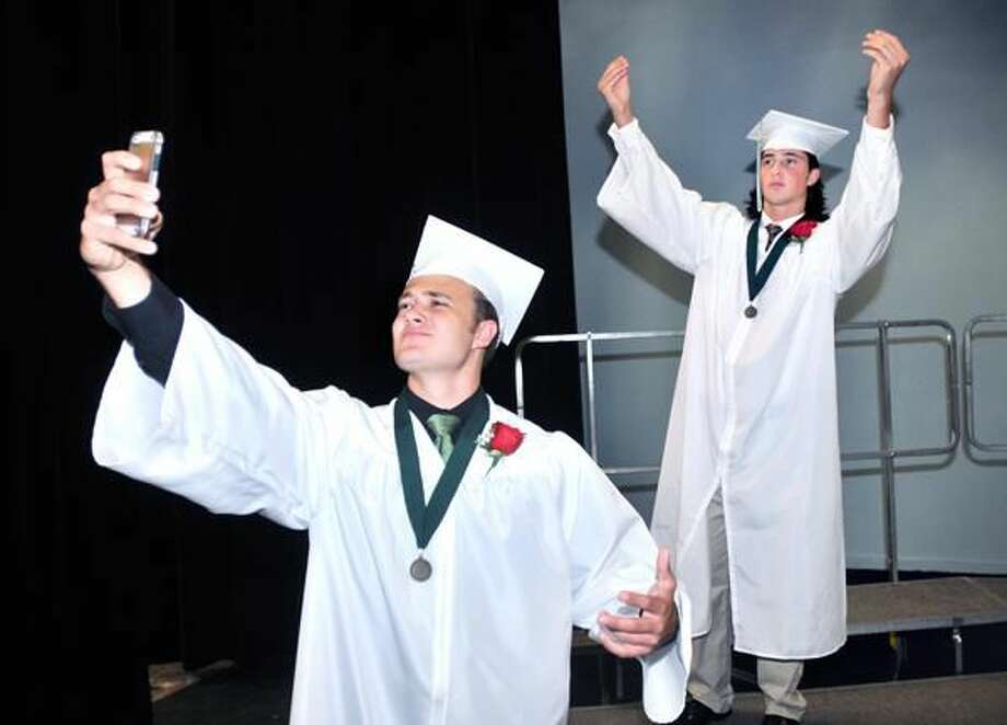 (Arnold Gold-New Haven Register) Michael Whalen (left) takes a selfie before graduation ceremonies at Hamden Hall Country Day School on 6/13/2014. At right striking a Johnny Manziel pose is Michael Breuler.