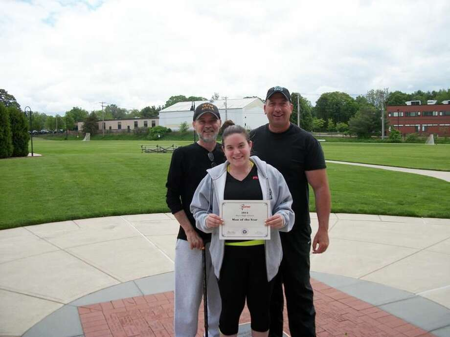Photo by Lynn Fredricksen Taylor Jacques, flanked by her father, Paul Jacques and Hamden Hall Head Coach A.J. Raccio, holds a certificate awarded posthumously to her twin brother, Jordan Jacques, who died earlier this year after a long illness. Jordan Jacques has been named Man of the Year by the U.S. Lacrosse Organization.