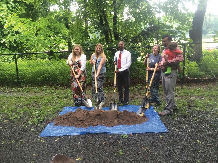 Submitted Photo by David Brown From left, Debe Redburn, Erin Thazhampallath, Mayor Scott Jackson, R-DOG President Vicki Seitz and Geen Thazhampallath attended a ground breaking ceremony at the dog park on Waite Street recently. Dog park enthusiast, Bob Jarrett, who died last year, will be memorialized at the park with the donation of a brick patio area and two benches, a gift from his family, daughters Redburn and Thazhampallath.