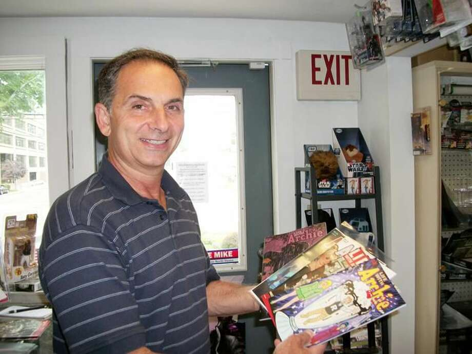 Photo by Lynn Fredricksen Dave Yaccarino, owner of D Jís Comics in North Haven, displays the five different covers of ìLife with Archie, No. 36î in which the iconic comic book character Archie Andrews dies. Andrews, a beloved all-American type, died from a gunshot wound he received as he defended a friend.