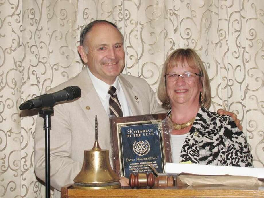 Submitted Photo North Haven Rotarian of the Year David P. Marchesseault accepted the honor in early June from last year's recipient, Bernadette Casella.