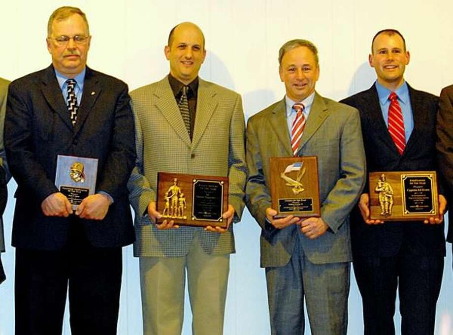 Photo by Joseph Cole Hamden Elks Community Service AwardsHonorees, from left to right, are Karl Olson, Thomas Ragozzino, William Earley Jr. and Ed Evers.