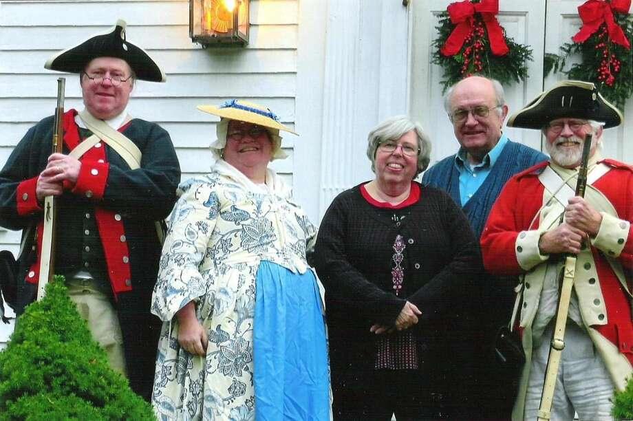 Henry Bessonett, Alice Bessonett, Sue Iverson, Bob Iverson, and Bill Duncan posing in front of the Iversons' Rising Sun Tavern.