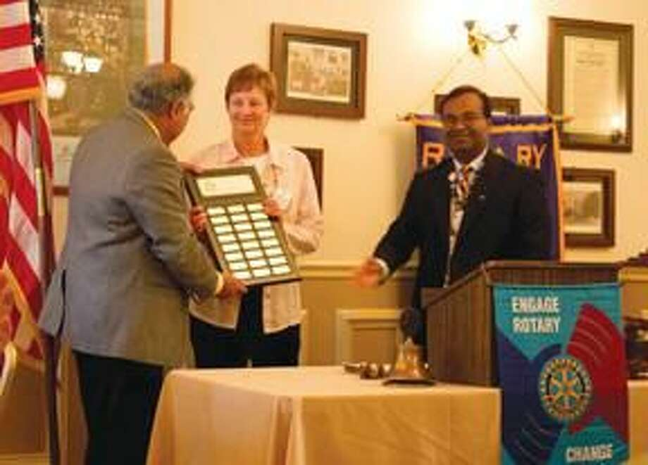 Submitted Photo Cathy Forsberg is shown receiving the honor with District Governor Mukund Nori and outgoing Hamden Rotary Club President Mohammad Elahee.