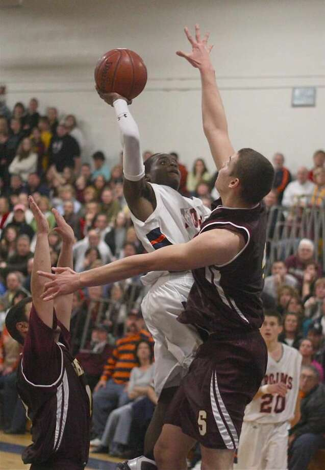 Lyman Hall sophomore Rich Bronson drives to the basket in traffic against Sheehan. Bronson scored a team-high 15 points. (Photo by Russ McCreven)