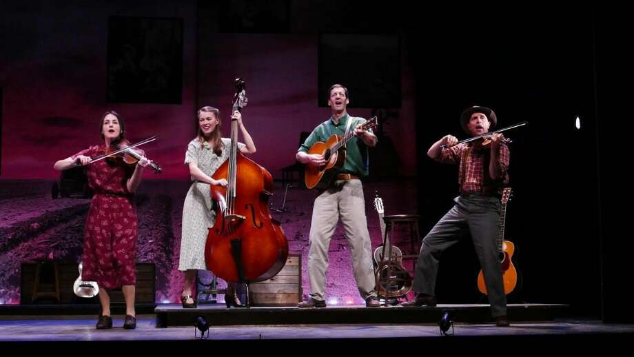 """From Left, Leenya Rideout, Katie Barton, David M. Lutken (as Woody Guthrie), and David Finch in """"Woody Sez: The Life and Music of Woody Guthrie"""" at Westport Country Playhouse, now playing through Jan. 20."""