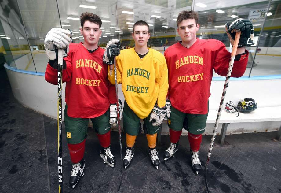 The Gethings brothers, left to right, Michael, Conor and John, have led the Hamden ice hockey team to a 4-2 start this season.