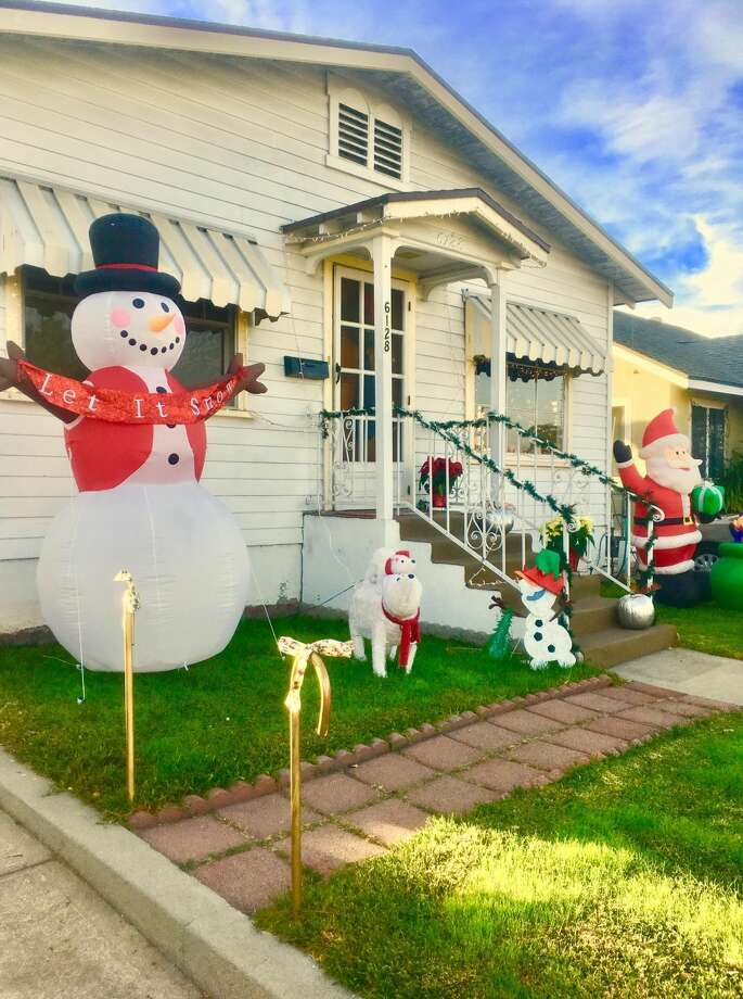 """A homeowner in sunny Los Angeles got into the Christmas spirit, including a snowman fantasizing, """"Let it snow."""""""