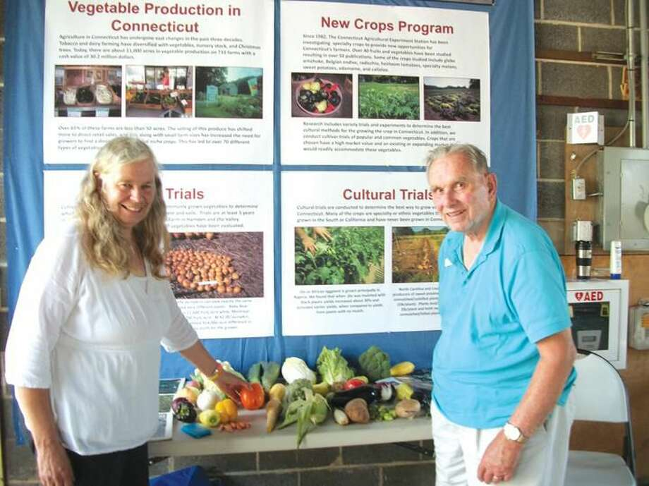 Photo by Lynn Fredricksen Abigail Maynard, a horticulturist with the Connecticut Agricultural Experiment Station, and David Hill, who started the New Crops Program in 1982, discuss their work at Plant Science Day last week at the CAES in Hamden.