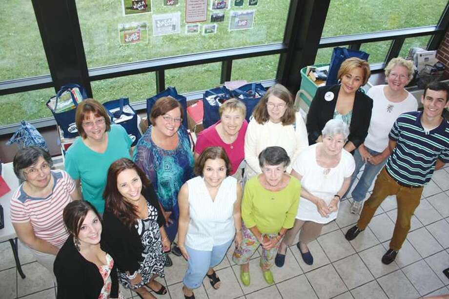 Submitted Photo Pictured are Friends of the North Haven Library and Carter Mario employees.