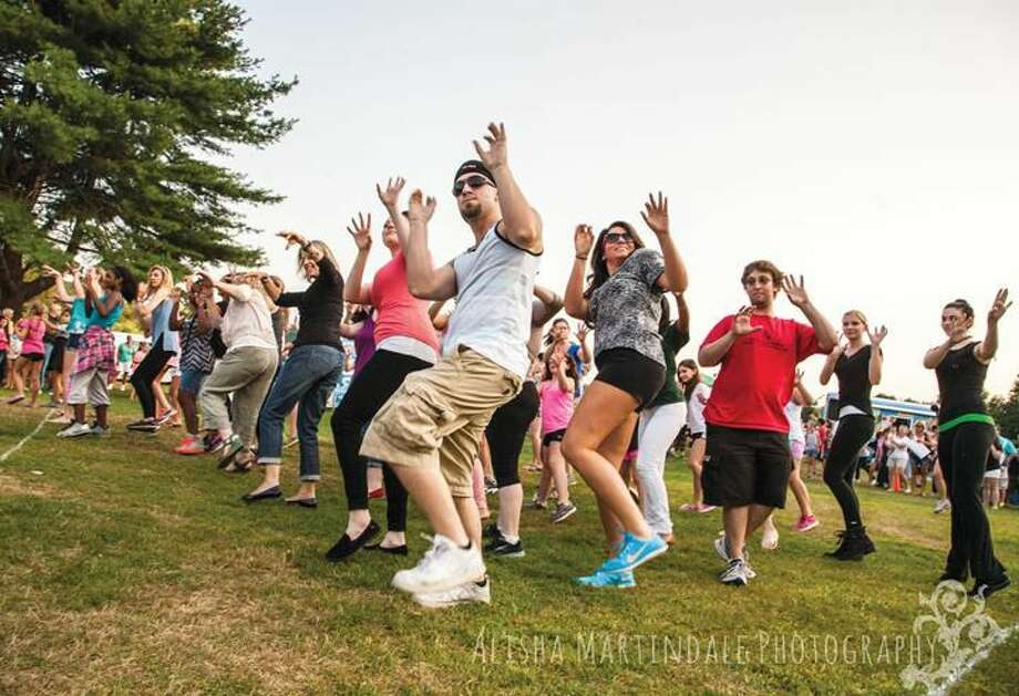 Submitted Photo by Alisha Martindale Photography Area residents participate in a flash mob at Friday's Hamden Concert Series.