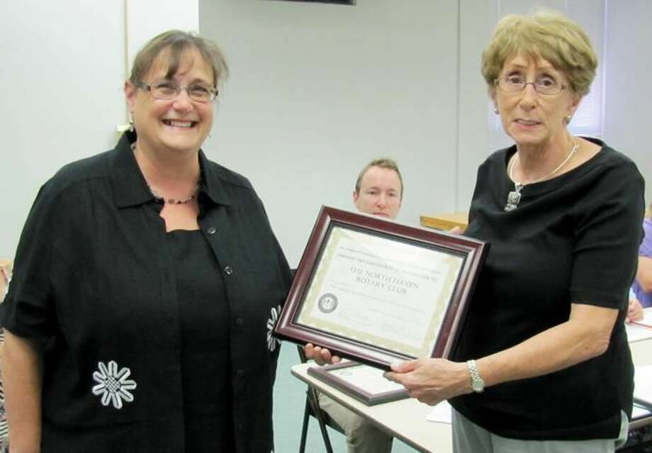"""Submitted Photo Donna Malley, right, Community Services Commission Chair, presents a """"Certificate of Recognition"""" to the 2013-14 president of the North Haven Rotary Club, Debbie Volain, as commission member Marc Fasano looks on."""