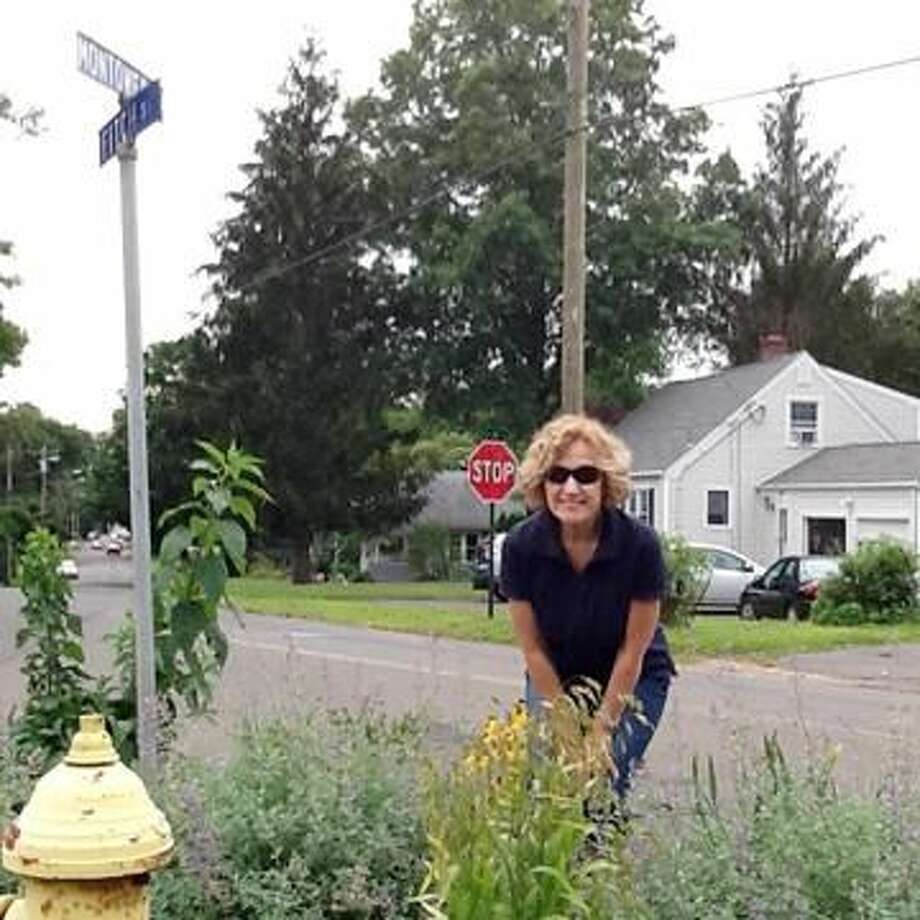Submitted Photo Marge Quinn with her garden on the corner of Montowese and Fitch streets.