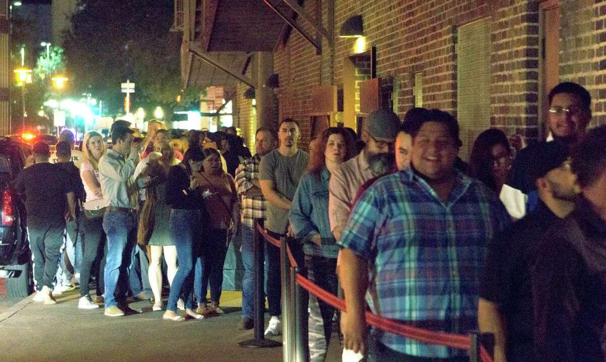 Dave Chappelle fans wait Monday night to get into the Aztec Theater for the comedian's surprise show, which was announced earlier in the day. Tickets for the show sold out in minutes, many of them online via Ticketmaster.