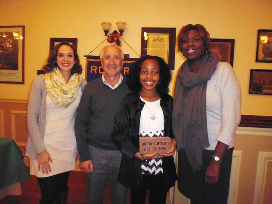 Submitted Photo Left to right are Stephanie Manle, teacher; Lee Campo, Rotary Club president; Student of the Month Imani Gatison; and Principal Karen Butler.