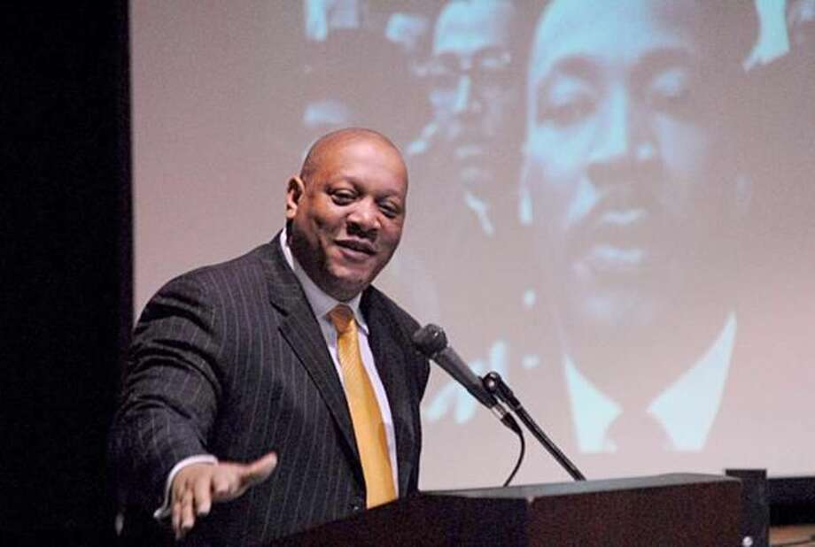 Photo by Joseph Cole President of the Connecticut State Conference of the NAACP Scot X. Esdaile speaks at Miller Cultural Complex, Jan. 15, as part of the Martin Luther King Jr. Day Celebration.