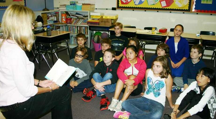 Submitted Photo Hamden Hall fifth-grade teacher Monica Emanuelson of North Haven reads aloud to her students as part of the Global Read Aloud program.