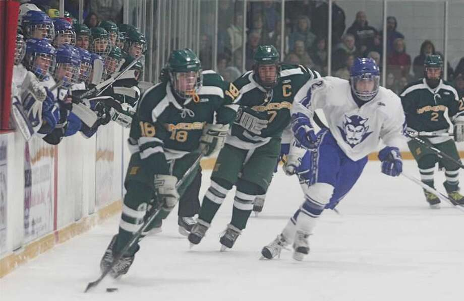 Hamden's Jim Burt skates with the puck along the boards. (Photo by Russ McCreven)