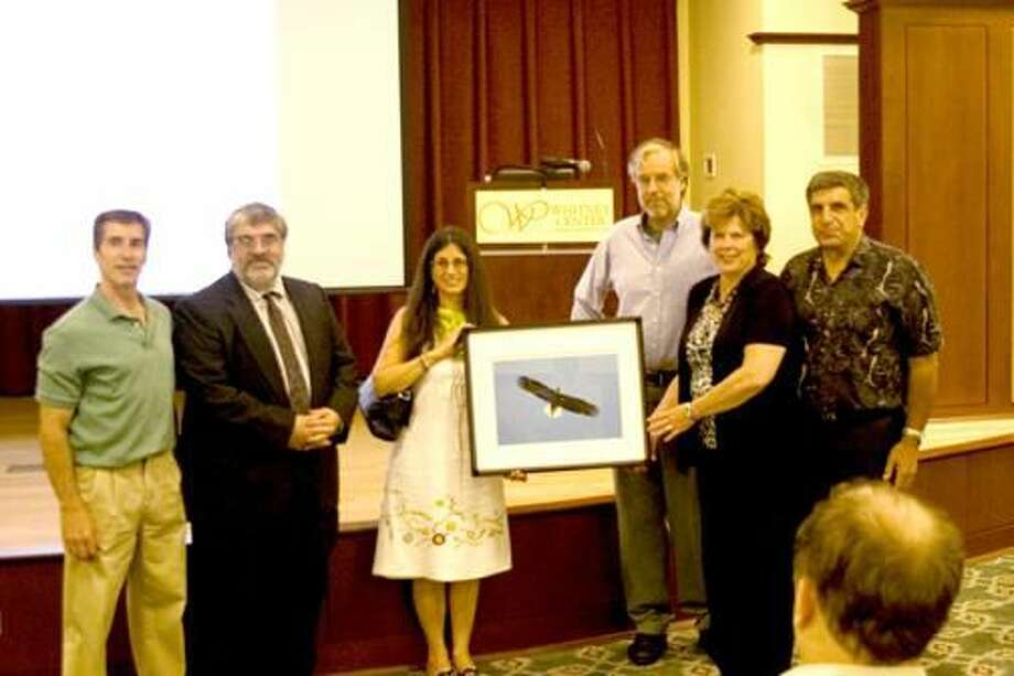 Submitted Photo Land Trust president Jim Sirch presents a photo of one of the Hamden eagles to the Garguilo family. (left to right: Joseph Gargiulo, Frank Gargiulo, Angelina Genovese, Jim Sirch, Mary Lou Garguilo and Henry Garguilo).