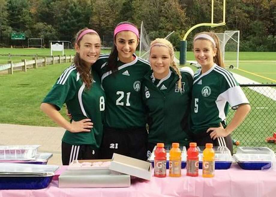 Submitted Photo Hamden Hall Country Day School Girls' Varsity Soccer captains, from left, Maya Harlan of Hamden, Bianca Tomassini of North Branford, Olivia D'Anna of Milford and Doria Weiss of Orange, raised more than $500 for breast cancer on their Senior Day.